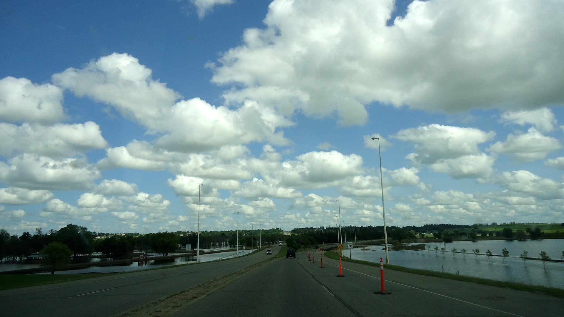 Excessive rainfall over southwestern Manitoba this summer resulted in significant flooding along the Assiniboine river. Brandon, MB – pictured above – was one of many communities hit hard by the widespread flooding.